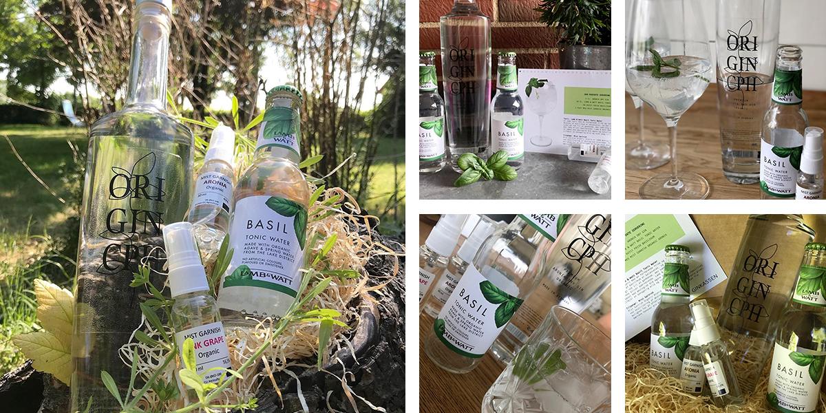 Juni måneds Ginkasse. Aronia Dry Gin, Lamb & Watt Basil Tonic, Aronia spray, rød grape spray og opskriftskort.